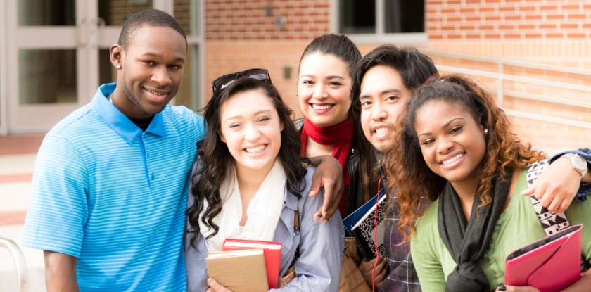 Education: Multi-ethnic group of college friends hang out before class.